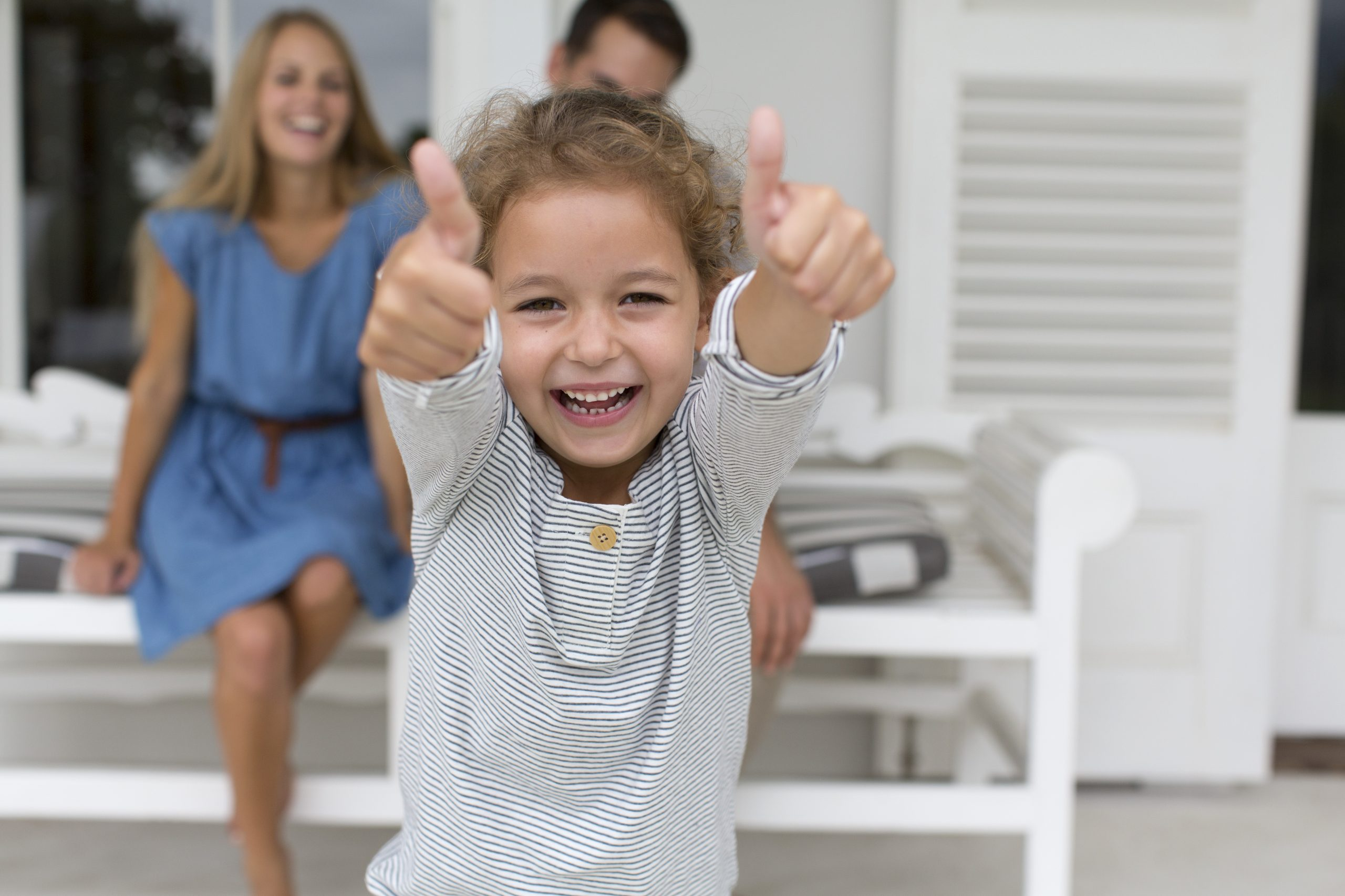 Portrait enthusiastic girl gesturing thumbs up