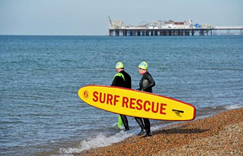 UK Weather - Lifeguard Training on Cold Sunny Morning in Brighton